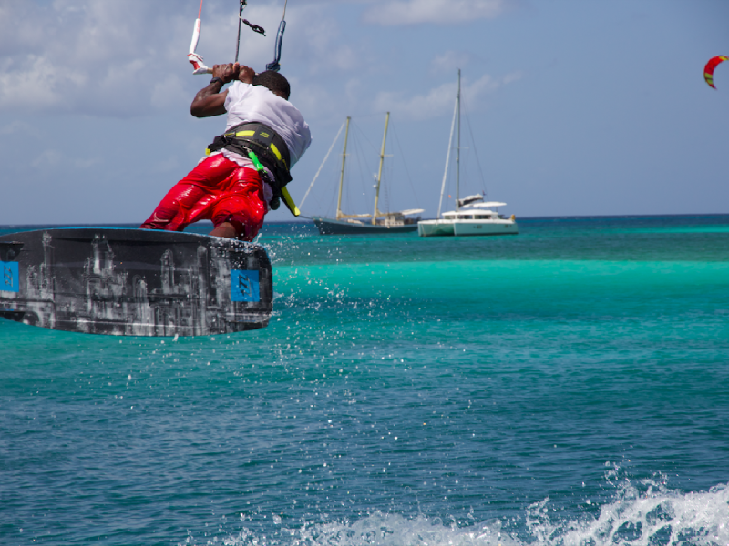 Local rider jump 800x600 - Uncharted Kitesurfing - Grenadines