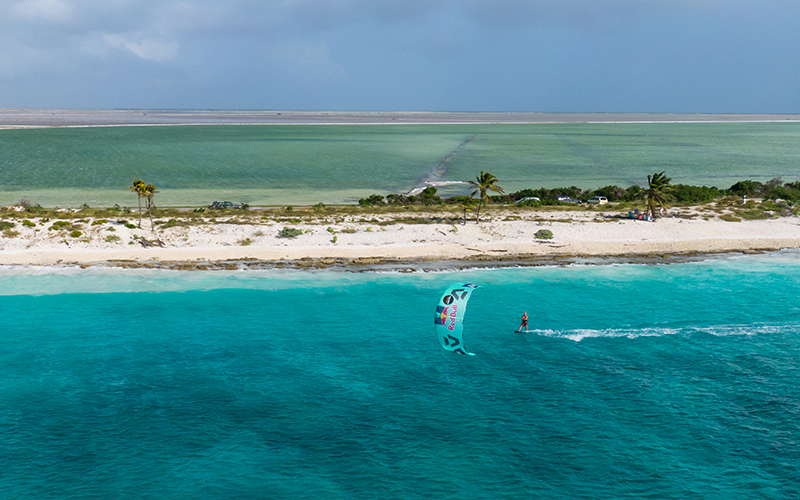 Lasse Walker with the pink salt ponds in the back shot by Arnaud Plas Fly Media Productions - Yndeleau - Kiting and sailing the world - Bonaire